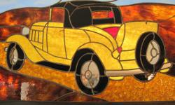 For sale, as envisioned, are 2 (2) multi-color, discolored glass collaborations including a distinctively and beautifully crafted antique car and a plane of like vintage. Both pieces were commissioned