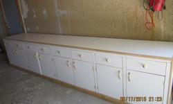 "CUSTOM BUILT WHITE LAMINATE STORAGE CABINET. GOOD FOR GARAGE OR REC. ROOM. GREAT CONDITION. 11'10"" WIDE 30""HIGH 24""DEEP. WILL NEED TRUCK OR TRAILER & ""MUSCLE"" TO MOVE."