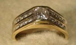 Stock #239 Surprise that special man in your life with this stunning diamond men's band. The band is 14K yellow gold. The center stone is a round .75 carat diamond. The color of the diamond is G. Ther