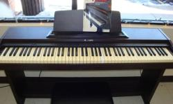 SUZUKI Digital Piano, Model HP-80 FULL 88 key keyboard - Beginners lesson book Plays: Piano, Organ, Harps, Vibe, Strings, Metronome, and Demonstration Modes Has comfortable stool. All in GOOD shape!