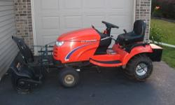 "Used 2006 Symplicity Broadmoor 16HP Garden Tractor with 44"" mower deck, 42"" Single Stage Snow Blower with motorized chute control, chains, traction weight mount and vinyl cover. Great Condition. 236 h"