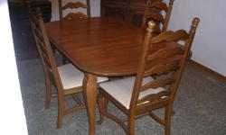 Type: Dining RoomType: SetsSolid Oak Queen Anne style table and chairs by Temple StuartThis is quality made furnishings acquired brand-new in 1980 and is in fresh condition original owner, it has been