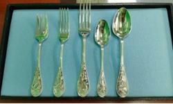 I have a set of Tiffany Audubon Sterling silver flatware. It's all been used only a few times. Have receipts. Purchased at Tiffany's Cherry Creek, the year 2002. I have 12 of everything plus all the i