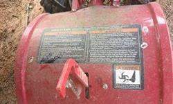 6.5 HP Troy Builtplus tSuperBronco Garden Tiller with Briggs and Stratton Motor and rear tine. Model # 12210. This tiller is in excellent condition. It looks dirty in the pictures but hey