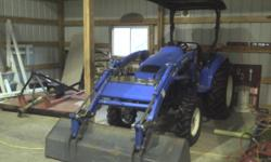 One owner/driver and always kept in building and serviced. Used only on my property. This 2002 Deisel TC40 3 point hitch with ROPS & Canopy has an upgrade on the headlamps with side and front lenses.