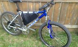 Trip 4100 aluminum frame Mountainbike with front shock, all shimano elements, and disc front brakes With high-end Crystalyte ebike motor kit ($1200 simply for the ebike kit) and very high tech lithium