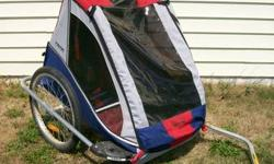 Trip Trailer/Stroller, rarely utilized, fresh.  Shall bring 1 or 2 children. The very first two images show the trailer with the weather cover. The 3rd and Fourth pictures reveal the display cover. 5t