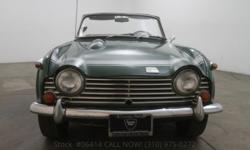 1968 Triumph TR2501968 Triumph TR250 in British racing green with black interior and a black vinyl top. Excellent color combination. Comes equipped with a 5 speed manual transmission, dual stromberg c