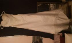Size 8 strapless brand new never worn ivory with vail. $350.00 obo. Flower girls dress with sandles $75.00.