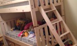Twin Over Twin Bunk Beds - nude real wood, comes with mattresses. Replacement dowels need to be shortened a bit. I lost the original dowels when I moved one month ago. Bed is in superb condition! It w
