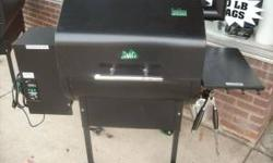 Used Daniel Boone pellet smoker / BBQ. This was traded in on a larger model after less than a months use. This is your chance to save some money on a like new wood pellet grill. This unit has digital