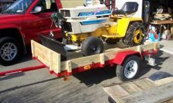Utility trailer is 4 x 8, excellent condition. Garden tractor is a 1974 International Cub Cadet 1000. 44 inch mower deck, snowplow, wheel weights, ag tires, chains, electric winch for snow plow Will s