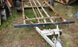 This is the frame to a utility trailer that was a pop up camper. It has a trailing arm type suspension with coil over shocks. it is 12 foot 7 inches long and 53 inches wide. It measures 16.5 feet from