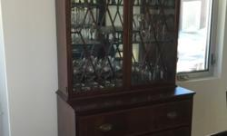 This beautiful secretary desk has a mirrored hutch with glass shelves and a light to illuminate valuables. All glass is in perfect original condition within cabinet doors. The items in secretary are n