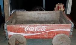 "I have a vintage Coca Cola wooden crate wagon. About 18"" long , 12 "" wide, and 8"" tall. It is all wood. Wheels turn with no problem. No wood rot. $55.00"