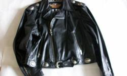 Supple heavy grade black leather, heavy duty zipper front with signatureH D winged zipper pull, classic motorcycle jacket styling, zippered cuffs, vintage nickel conchos on epulates and waist, lower m