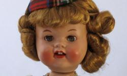 The beloved hard-plastic walking doll made in the 1950s by Roddy, the famed English dollmaker. This Scottish lass has a strawberry blonde mohair wig, blue sleep eyes with fiber eyelashes, open rosy mo