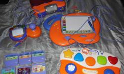 """Used Vtech V.smile video gaming console for toddlers. Comes with 6 """"smartridges"""" pictured, 1 regular controller, and 1 Art Studio controller. *Note the battery compartment cover is missing on bottom o"""