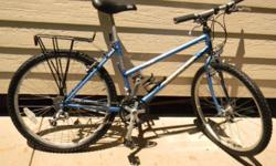 This is a Wheeler ProLine 21-Speed 2000 Oversized Mountain Bike with rear rack in good technical and aesthetic condition. It has 21 speeds, and rides great. It makes both a great commuter and off-road