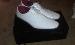 Men's White patent leather shoes size 10worn oncethey are a little long in the toes, perfect for someone who is a 10 to 11 shoe size.They are very nice looking shoes, would go great with a tuxedo or f