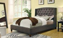 Create a centerpiece in your bedroom with this stunning upholstered bed.  Featuring a beautiful tan or dark brown upholstery, it has a grandly-scaled headboard that is decorated with classy button tuf