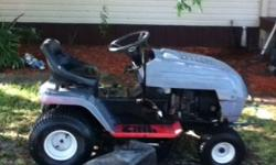 it is a wizard riding lawn mower runs great has a 42 in deck just needs a tower to make it mow. Runs great tires has a slow leak will crank up easy only think wrong with it is the deck needs a tower f
