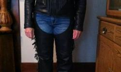 Women's black leather motorcycle coat with fringe. Size Medium. Jacket in good condition, has zip out liner, carefully worn, really warm. Leather King brand $75.00.  Women's black leather bike chaps w
