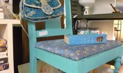 Vintage chair painted aqua color and distressed for age and character. Located at Four Seasons Vintage, 5710 Kingston Pike, Knoxville, TN 37919. Telephone at 865-247-XXXX.