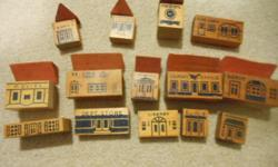 From the 40/50's, 14 antique wooden building blocks with stenciled, painted building images on the blocks. Largest is 3 inches wide with smallest being 1 1/2 inches wide. VG condition. 262-782-4066