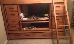 I am selling our wooden bunk beds. The bottom bunk is a push in trundle. This bed has built in dressers and a center computer area or tv area. I'm including one twin mattress that is like brand new. I