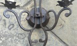 For sale is a wrought iron 2 candle wall sconce light fixture. Came from a house in Carmel Valley, removed due to a remodel. It's in excellent condition and works perfectly. Asking $55 each OBO. 2 available.