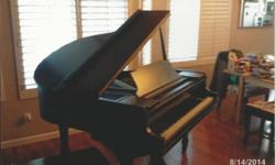 This is a 1926 Wurlitzer Baby Grand Piano for sale. The piano needs tuning /cleaning, and there are 8 keys with chips in them that may be repaired. One of the black keys, G#, is missing 1/2, and this