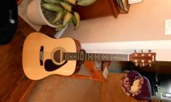 This is a Yamaha FD01S Acoustic Folk Guitar that we bought for our children a couple of years back. It is in good condition. It likewise has a stand, vinyl bring case, and assorted strings. We paid $1