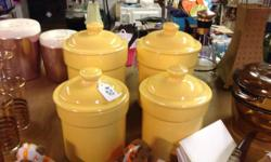 YELLOW VINTAGE CANISTER SET. $20. This collection includes two big and 2 small canisters! They're a quite yellow! And they all have their lids! They're in fantastic form! And would certainly make a br
