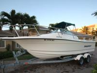 2004 TROPHY PRO 2002 WALK AROUND. THE BOAT HAS VERY,