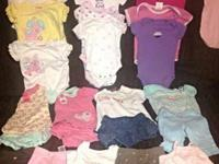 I'm selling these 28 pieces of size 0-6 months clothes,
