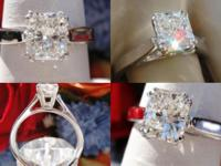 This is a 0.91CT Radiant Diamond Engagement Ring. The