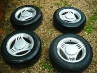 I am selling my Ford Mustang rims with tires they are
