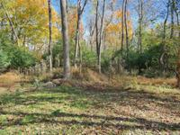 Gorgeous wooded 35+ acres located in Oak Hills School