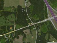 Acreage with Development Potential. Road Frontage along