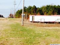 This corner, commercial 3 Acre tract is located at the
