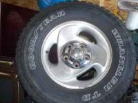 up for grabs is a full set of 4 wheels tires & center