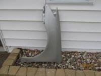 This is a OEM driver side front fender for a 2002-2006