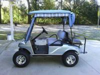 "02 club car, 6"" jakes lift, new flip rear seat, lights,"