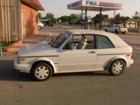 Silver with black leather interior, heated seats,