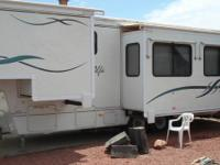 04 Alfa Sun 5th wheel for sale. 30 ft. 2 slides. Lived