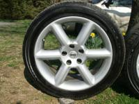 Set of 4 tires and rims that came off a 2004 350Z. 2 of