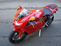 his Ducati Superbike 749 in Hot Red comes in new