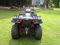This is a 05 polaris 700 sportsman with free plow it's