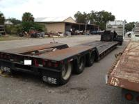 This is a 2006 50 Ton Globe lowboy trailer, hydraulic
